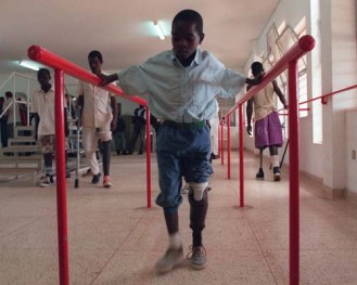 9 year old Vitorino Chilor tires out his new leg for the first time at the Huambo Orthopedic centre, Tuesday Febrary 17, 1998. Vitorino is one of 90 000 Angolans who have been maimed by land mines.(AP Photo/Adil Bradlow)